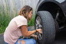 Desperate Woman Because Of Her Punctured Car Wheel