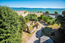 Castiglione Del Lago Fortress Fort Wall Wide High Angle View In Umbria, Italy Rocca Medievale Del Leone By Lake Trasimeno In Sunny Summer With Old Ruins