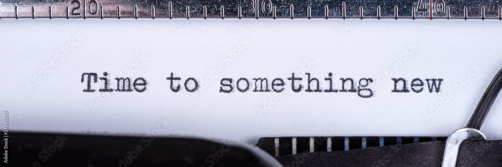 Time to something new - written on a vintage typewriter. Panoramic image