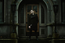 Young Elegant Vampire In Front Of A Mausoleum