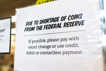 Request Sign At Grocery Store Shop Entrance Due To Shortages Of Coins From Federal Reserve To Use Exact Change Or Pay With Credit Debit Contactless Card