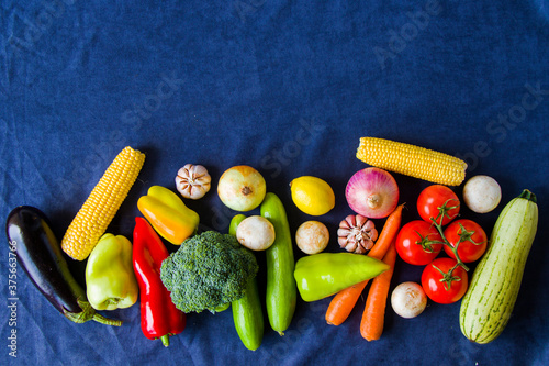 Fotografija Colorful vegetables mix, ingredients and raw and organic vegetarian food, space