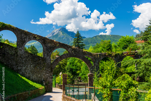 Obraz Ancient Aqueduct of Barga was built in the course of the 15th century. It's a stone construction that assured water to the fountains in the historical centre. Barga, Garfagnana - Tuscany,. Italy - fototapety do salonu