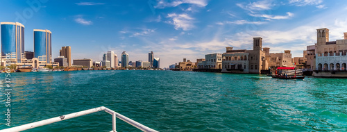 Fényképezés A panorama view from a small boat of the upper reaches of the Dubai Creek in the