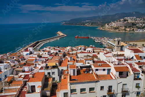 View of the Peniscola town Valencia, Spain. Tourism, Spanish landscape with deep blue sea and mediterranean architecture.