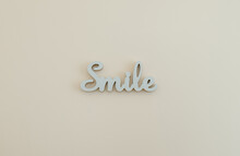 A Wood Letters Smile On The Wall.