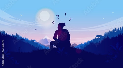 Female person sitting in nature thinking and wondering - Woman looking at landscape asking her self questions Fototapet
