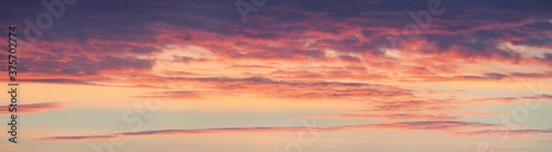 Papel de parede Colorful sky with glowing clouds in morning fog at sunrise