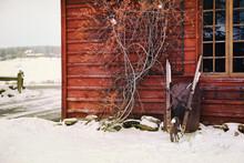 Winter Scene With Barn And Wheelbarrow