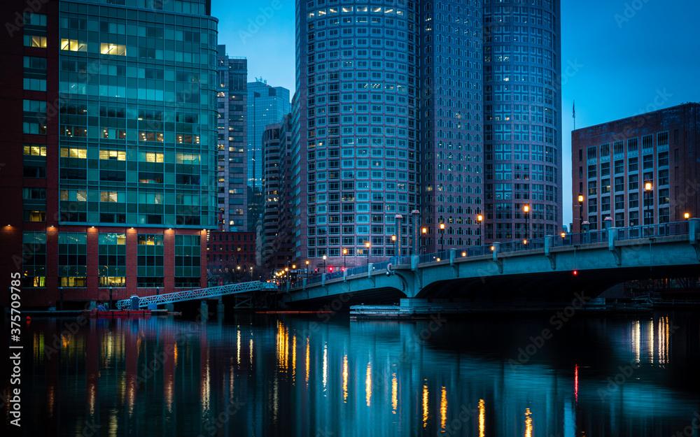 Fototapeta Futuristic image of Boston Financial District over the Boston Harbor at twilight