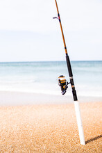 Fishing Rod And Reel On Beach