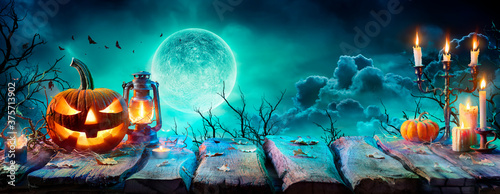 Jack O' Lantern On Table In Spooky Night - Halloween With Full Moon Wallpaper Mural