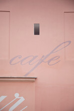 Cafe Sign On A Pink Building Wall