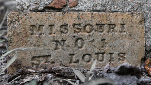 Fotografija Close up of a vintage concrete brick cornerstone engraved with St Louis Missouri