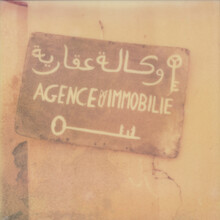 Old Pink Painted Sign In Arabic With Key Illustrations