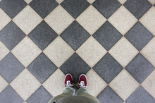 Red Sneakers On Black White Stone Floor, Footsie, Personal Perspective