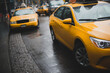 Yellow taxi cabs on a rainy day in the city