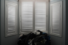 Black And White Window With Shutters In A Bedroom With A White Background