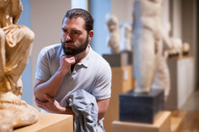 Man Looking At Stone Architect...