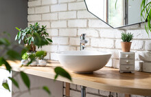 Bathroom With White Bricks Wall, Stylish Wash Basin, Mirror And A Lof Of Green Plants. Spa At Home And Houseplant. Cozy And Minimalist Interior.