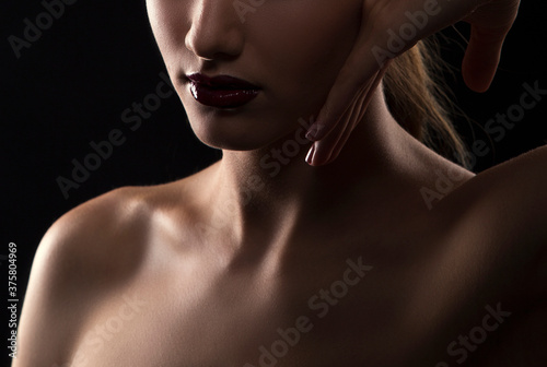 Lips, hand, shoulders, partial beauty portrait of a young woman with healthy skin Fototapeta