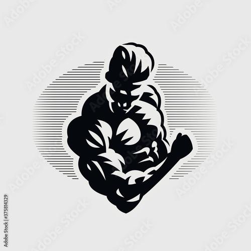Slika na platnu Muscular man squeezes his biceps.