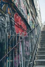Graffiti On A Wall In Monmartre, Paris.