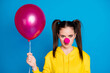 canvas print picture - Close-up portrait of nice attractive funny serious brown-haired teen girl clown holding in hand air ball festal fest event occasion isolated on bright vivid shine vibrant blue color background