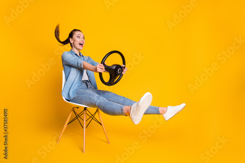 Full length profile side photo of astonished positive girl taxi rider sit chair Fototapet