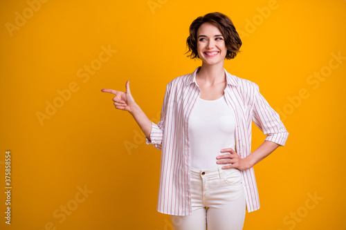 Fotografie, Tablou Photo of cute lovely student girl hand hip point finger look empty space certain