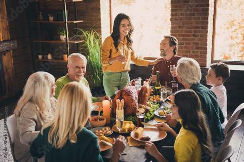 Fototapeta Portrait of nice attractive adorable cheerful family small little kids meeting mom saying toast congratulating harvest festal event occasion at modern loft industrial wooden interior house obraz