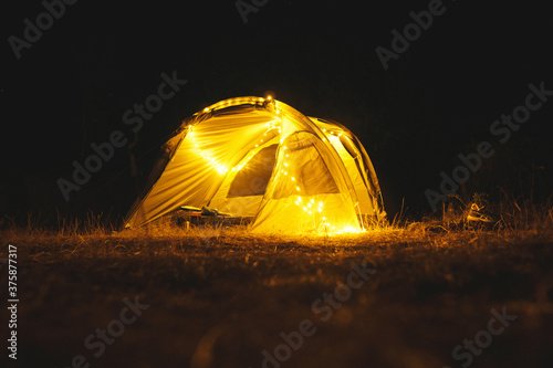 fairy lights in tent at night Fotobehang