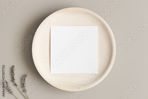 Tela Invitation square card mockup on a wooden plate with lavender.