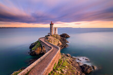 Petit Minou Lighthouse At Sunset. It Indicates To The Boats Wishing To Go To Brest, The Route To Follow To Enter The Harbor. It Forms An Alignment With The Portzic Lighthouse. It Also Has A Red Sector