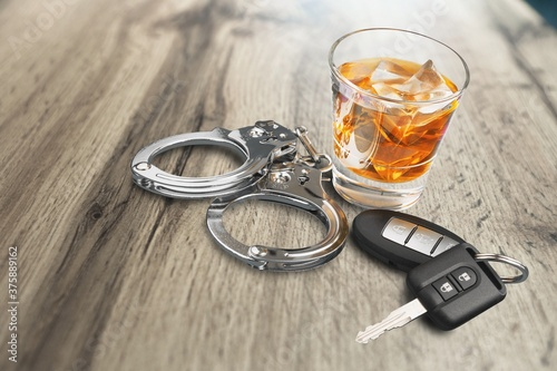 Fotografie, Obraz Whiskey with car keys and handcuffs concept for drinking and driving