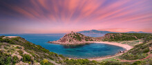 Panoramic Landscape Of Porticciolo Ancient Tower At Sunset With Long Exposure Pink Clouds