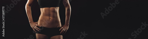 Fitness woman with sixpack abs Wallpaper Mural
