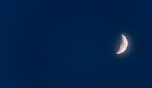 Half Moon Says Goodnight In A Dark Navy Blue Night Sky.