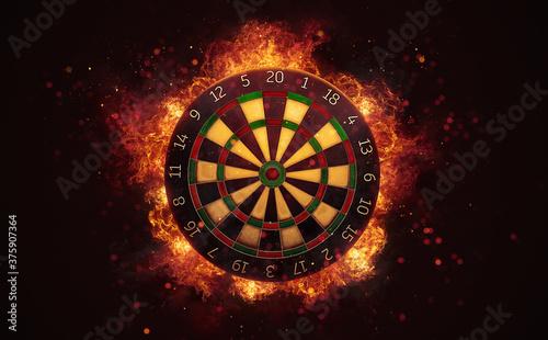 Dart board target in burning flames close up on dark brown background Wallpaper Mural