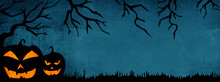 HALLOWEEN Background Banner Wide Panoramic Panorama Template -Silhouette Of Scary Carved Luminous Cartoon Pumpkins And Trees Isolated On Dark Blue Texture
