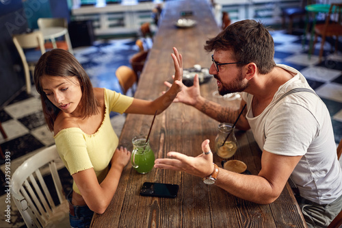 Young couple arguing in a cafe Wallpaper Mural