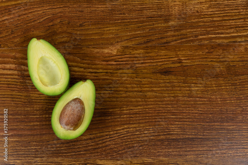 View of an avocado on wood table background