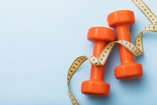 Dumbbells And Measuring Tape O...