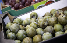 Green Plums In A Market
