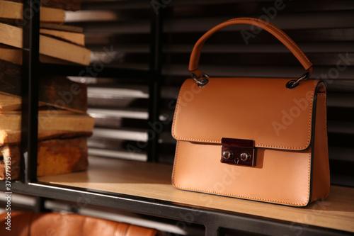 Stylish woman's bag on shelf in boutique Tableau sur Toile