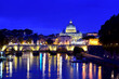 Saint Peter Cathedral and bridge at night in Rome, Italy