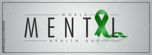 Foto World Mental Health Day Text with Green Ribbon Cross on Grey Background