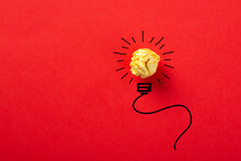 Creative Idea, Inspiration, New Idea And Innovation Concept With Crumpled Paper Light Bulb