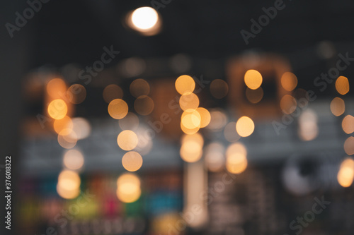 Bokeh from a warm light bulb in the cafe Canvas Print