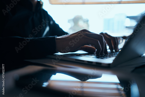 Fototapety, obrazy: Business man freelancer working in a cafe laptops communication phone room manager model